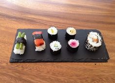 A slate plate ideal for sushi.