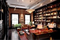Loft in NY. Fan of making the couches face each other and the brick wall.
