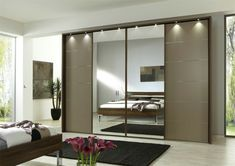 http://www.highwayswest.com/the-most-popular-choices-for-wardrobe-with-sliding-doors/black-rug-for-contemporary-bedroom-plan-with-modern-wardrobe-design-using-mirrored-sliding-doors-and-stylish-track-lighting/
