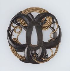 Tsuba with design of ropes and anchors. Japanese Edo period, circa mid-19th century.