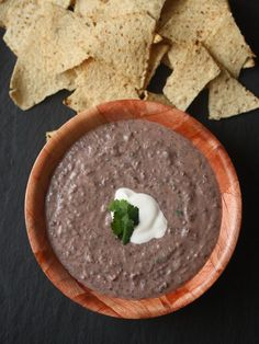 This black bean dip recipe is the perfect appetizer for any party. Sour cream makes it creamy, but Greek yogurt can be substituted for a healthy version.