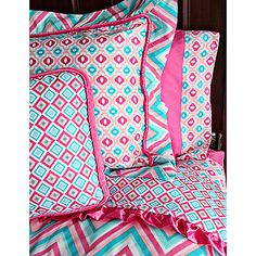 She's growing up and you need bedding that will grow with her in style and comfort. This Caden Lane Ikat Pink bedding has a fun print with grownup style.