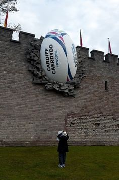 giant rugby ball breaking the wall of Cardiff