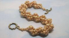 Cream spiral bracelet  8 inch by Braceletsbymaryle on Etsy, $28.00