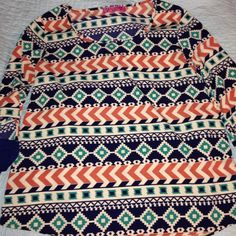 Fun Aztec Print Blouse Super cute Aztec printed blouse, with a cute detail on the sleeve! Long enough to wear with leggings but also looks cute with jeans! It is navy, dark real, burnt orange, and cream!! Has only been worn once so is still in perfect condition!!  Almost Pink Tops Blouses
