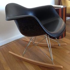Just restored!  Another beautiful example of an earlier Eames shell, reimagined!  Black fiberglass with snowy white fibers and black vinyl upholstery.  Received a new set of shock mounts and rocker base from Modern Conscience. Summit Plastics.