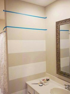 Love these bold stripes and a small bath might be just the place to try it??