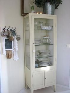 Old Dentist Cabinet as China Cabinet, Dining room. White, Grey, Black, Chippy, Shabby Chic, Whitewashed, Cottage, French Country, Rustic, Swedish decor Idea. ***Pinned by oldattic ***