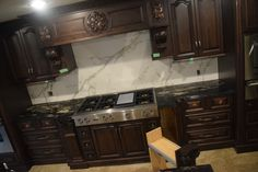 Granite countertop & Dekton backsplash!