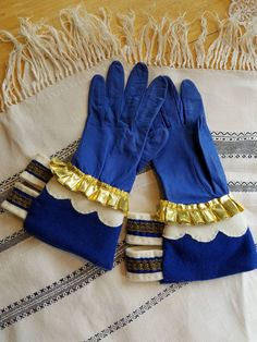 SCA Gloves ~ I'm not a glover but I always wanted a pair of late period fancy gloves. I Macgyvered this pair together using a pair of premade kid gloves, wool scraps, and leftover trims. It came out pretty good.