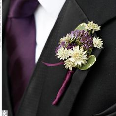 striking arrangements include astrantia as well as trachelium to match the plum-coloured tie.