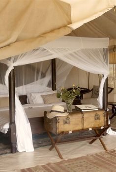Love this canopy bed with the trunk, exactly what I have in mind when I think of safari style interior. Cottar's Safari Camp - Maasai Mara, Kenya Glamping, Safari Bedroom, Estilo Colonial, British Colonial Decor, Safari Decorations, Campaign Furniture, Decoration Inspiration, Style Inspiration, West Indies