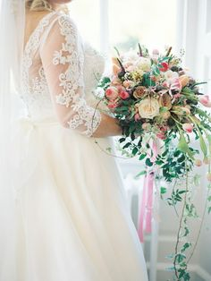 Bouquet of Quicksand and Sahara roses in blush pink and ivory, with trails of jasmine and textured ribbons created by Red Floral Architecture