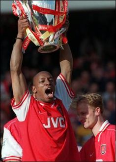Ian Wright (holding trophy) and Dennis Bergkamp (smirking), 2 all time Arsenal greats!