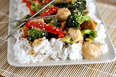 Sesame Chicken Stir-Fry Recipe Main Dishes with low sodium chicken broth, low sodium soy sauce, corn starch, sesame oil, boneless skinless chicken breasts, canola oil, broccoli florets, red bell pepper, fresh ginger, toasted sesame seeds, cooked rice