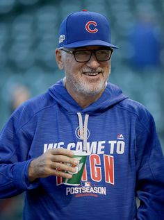 Manager Joe Maddon of the Chicago Cubs smiles during batting practice before the game against the San Francisco Giants at Wrigley Field on October 8, 2016 in Chicago, Illinois.
