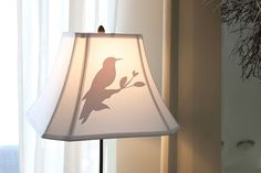 add vinyl to cheapie lampshades to dress them up!