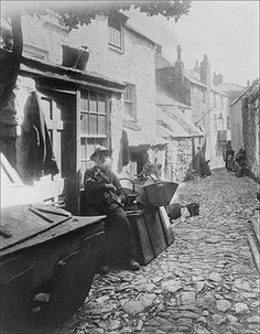 "St. Ives, Cornwall-This was taken in ""Pudding Bag Lane"" (Capel Court). The area was demolished in 1936 to make way for a car park. There was much anger at the time, but the authorities in the name of ""slum clearance"" called in the bulldozers anyway. Newlyn (and Mousehole) would have suffered a similar fate if WWII had not intervened.The old fisherman was known locally for carving ""joannies"". painted wooden dolls fashioned from sections of broken oars."
