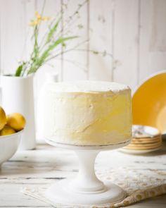 Summer lemon cake with lemon curd filling & vanilla swiss buttercream.