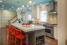 Orange bar stools, blue ceiling ... I love this colorful #kitchen. And the #pendant lights?! YES!