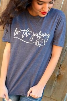 """Our Enjoy The Journey Tee is a LaRue Exclusive and features a heathered navy blue tee with the phrase """"Enjoy The Journey"""" and a camper silhouette printed in white. Made of 50% Cotton and 50% Polyester"""