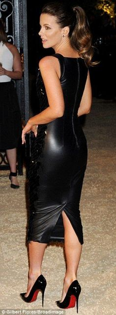 Scale mermaid: Kate Beckinsale wowed in a body hugging black leather and scale dress...
