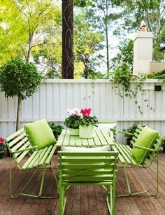 DIY: Spray paint an old junky patio set. Coordinate with several accent pillows. For more comfort, line seats with seat cushions.