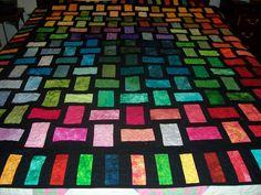 Stain Glass Batik quilt. $700.00, via Etsy.