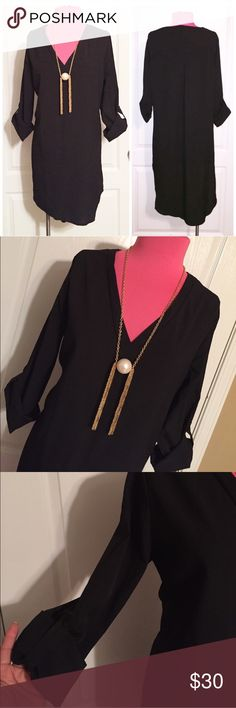 """🆕Hi Low V Neck Shirt Dress NWT. Pull over style shirt. No size in label. Approximate measurements: Armpit to hem is approximately 25""""-35"""", Bust 40"""" and waist 44"""". Based on measurements and style of dress it's best fit for a 12/14 or XL so I am listing it as such. 🖤No fading at all, the image has been lightened because dark colors are difficult to photograph🖤 NO TRADES Quinn-Tessential Desires Dresses High Low"""
