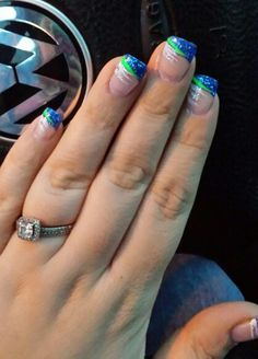 Great seahawk nails! Easy design.  Blue sparkly tips with green and silver lines. Superbowl bound 2015!!!