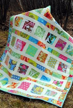 """Finished size is 41.5"""" x 49.5"""". This quilt pattern is very forgiving for the beginner, and there aren't many seams to match up, so the finished product always looks great! Fabric Requirements: 2 Charm Packs (71 charm squares) OR 1 layer cake OR 12 Fat Quarters 1 yard of neutral (white or cream) for sashing and borders 1.66 yards backing (60 inches) 1/2 yard for binding by ophelia franks"""