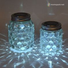 DIY: Easy Mason Jar Luminaries. All you need are mason jars, glue gun, flat marbles and battery tea lights. Glue flat side of marbles to mason jar, put light in jar and viola!