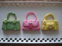 Handbag Cookies that are not completely flat and sort of realistic looking. Main covering plus all details are fondant and details were painted with silver and gold lustre dust and gel pastes.