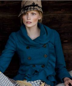 teal pea coat. Love the neckline and ruffles!