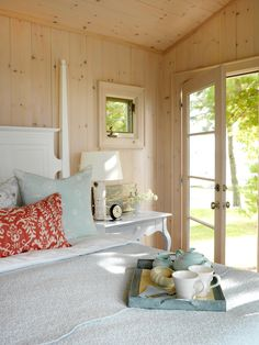 Natural wood walls create a comfortable foundation for this guest cottage