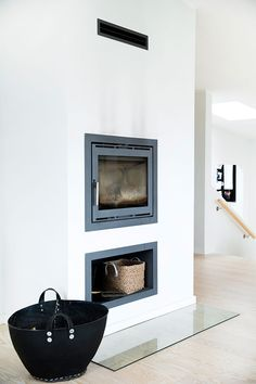 Simple White Wall and dark fireplace//