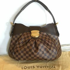 Like New Louis Vuitton Damier Sistina MM Like New inside and out! The leather strap feels crispy new Bought last year in the Louis Vuitton Boutique TN. Only flaw is inside the pocket where the serial number is a small pen mark! Comes with original dustbag. No trade. Bundle deal not included. Reasonable offers only. Louis Vuitton Bags Hobos