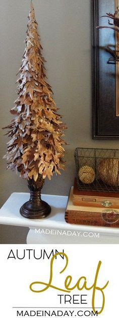 DIY Fall Leaf Tree, layer leaves on a cone to make this easy home decor for Fall, Autumn decor, leaf craft, tutorial on madeinaday.com via @thelovelymrsp