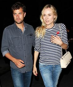 Diane Kruger in a striped Comme Des Garçons Play t-shirt, jeans, and a cream-colored Chanel bag