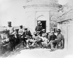 British soldiers on the roof of the Alumbagh, a large walled enclosure situated on the outskirts of Lucknow near the Cawnpore Road. During the Mutiny, it fell briefly under the control of the Indian mutineers. When British forces under the command of Havelock and Outram retook the Alumbagh on 23 September 1857, they continued to fortify it and use it in connection with military operations associated with the Relief of Lucknow. In November 1857, a force of c 5000 men was assembled there.