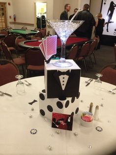 Decorations for a casino royale party combine the sexy cool of james bond with the fun action of the casino. set the scene with an elegant look featuring Casino Party Foods, Casino Party Decorations, Casino Night Party, Casino Theme Parties, Party Centerpieces, Party Themes, Party Ideas, Centerpiece Ideas, Vegas Party