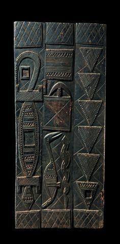 Africa | Door from the Nupe people of Nigeria | Wood; dark brown patina.  Consists of three wood planks