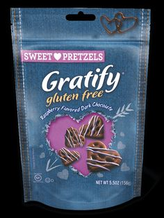 Raspberry Flavored Dark Chocolate Hearts -  It's love at first bite. Take a fun heart-shaped pretzel, dip it in delicious dark chocolate, and top it with a dreamy raspberry drizzle. Mmmm. Now that's a special valentine. #glutenfree #darkchocolate #hearts #raspberry #pretzels #coveredpretzels #sweet