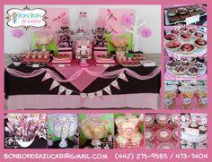 Mesa de dulces y postres en rosa con chocolate y tema de libélulas