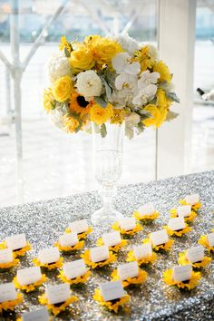 Place cards in displayed on a sunflower - so cute! {averyhouse}