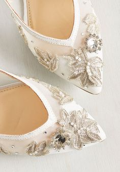 You've been calling on the perfect formal flat, but no answer. Until now! From Blue by Betsey Johnson, these white, satin-trimmed stunners - with their mesh uppers adorned in leafy, silver embroidery, pearly beads, and clear rhinestones - are here to shine for you.