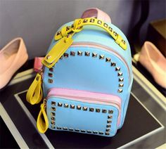 bfc1d48a33f0 2015 Summer Candy Color Panelled Rivet Backpacks Women Preppy Style Leather  Backpack School Travel Bag Mochila