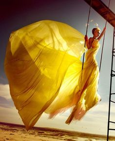 silky yellow dress billowing in wind