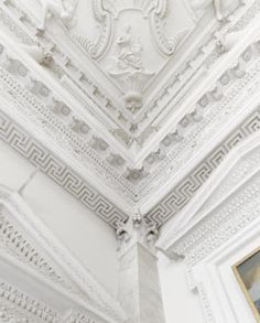 Detail of the plasterwork detail and ceiling in the Entrance Hall at Clandon Park, Surrey.