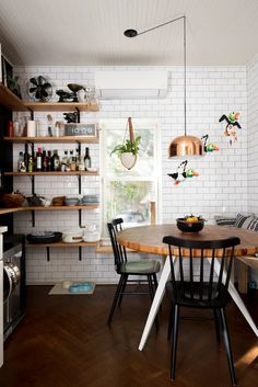 Breakfast nook with subway tiles and open shelves